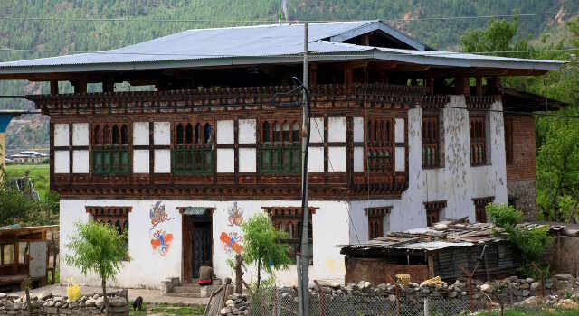 traditional bhutan house along bicycle tour route