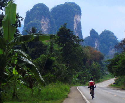 Cyclist riding through rural Thailand