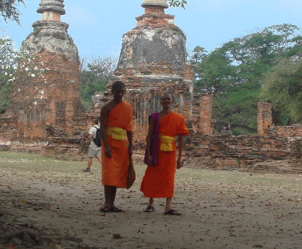 Monks walking through the ancient ruins