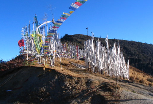 Prayer flags at top of bike ascent to Pelela Pass