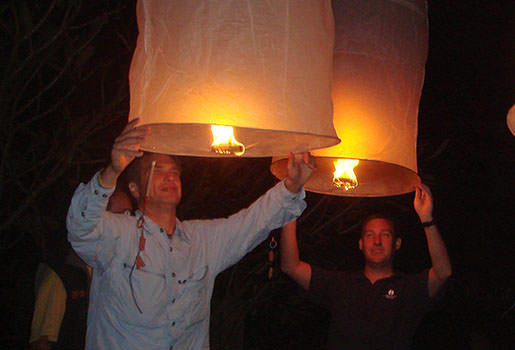 Launching fire balloons to bless our Thailand bicycle tour